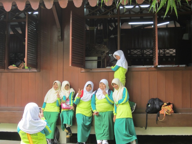 The student was taking a picture in front of Batik Workshop Room